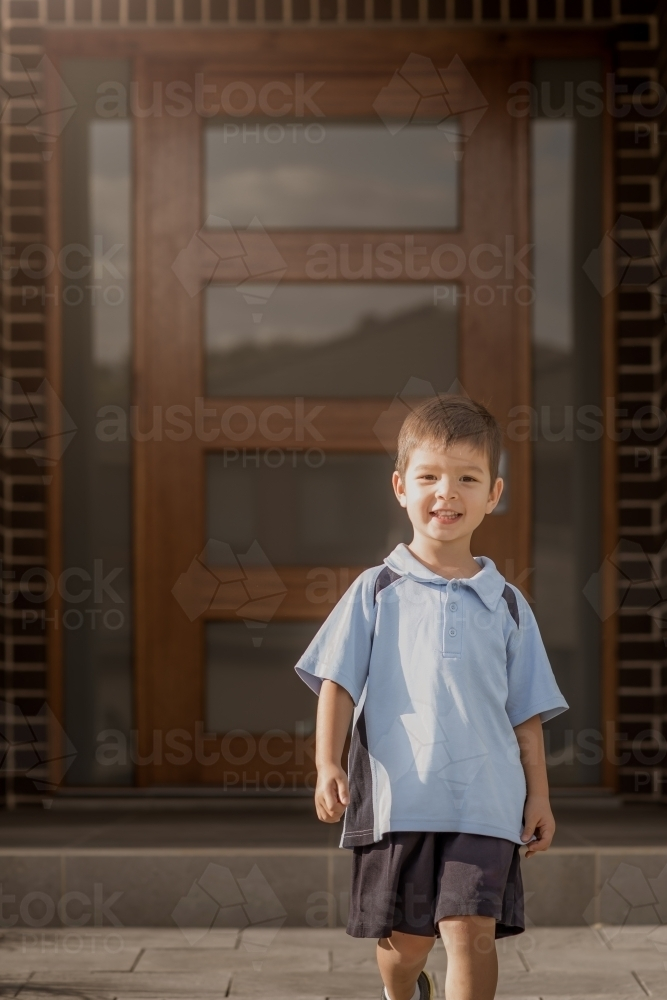 4 year old mixed race boy leaves home for his first day of preschool - Australian Stock Image