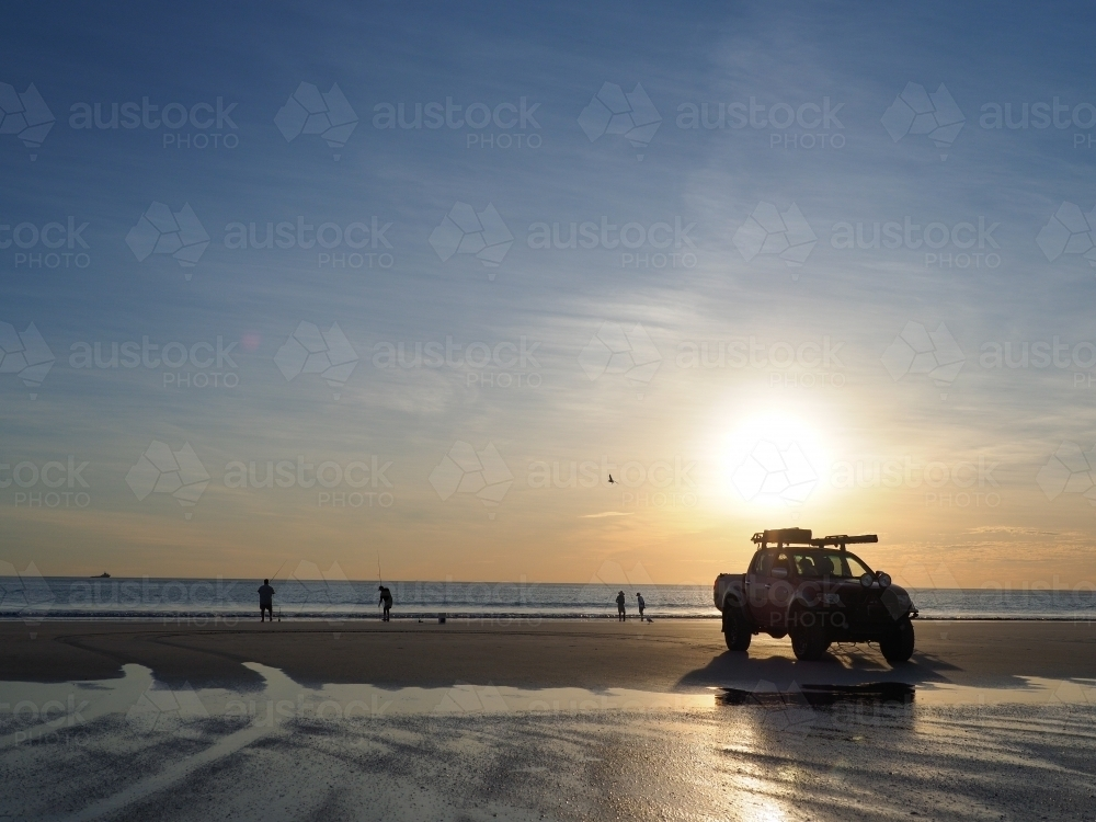 4WD on Cable Beach at Sunset - Australian Stock Image