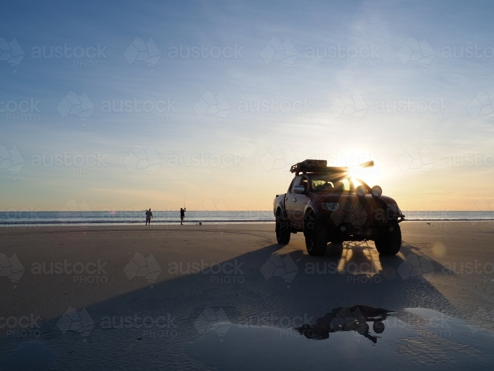 4WD Parked on Cable Beach with Two Men Fishing - Australian Stock Image