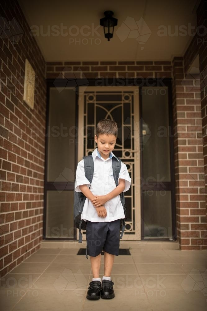 5 year old mixed race boy wearing his school uniform on his first day of school - Australian Stock Image