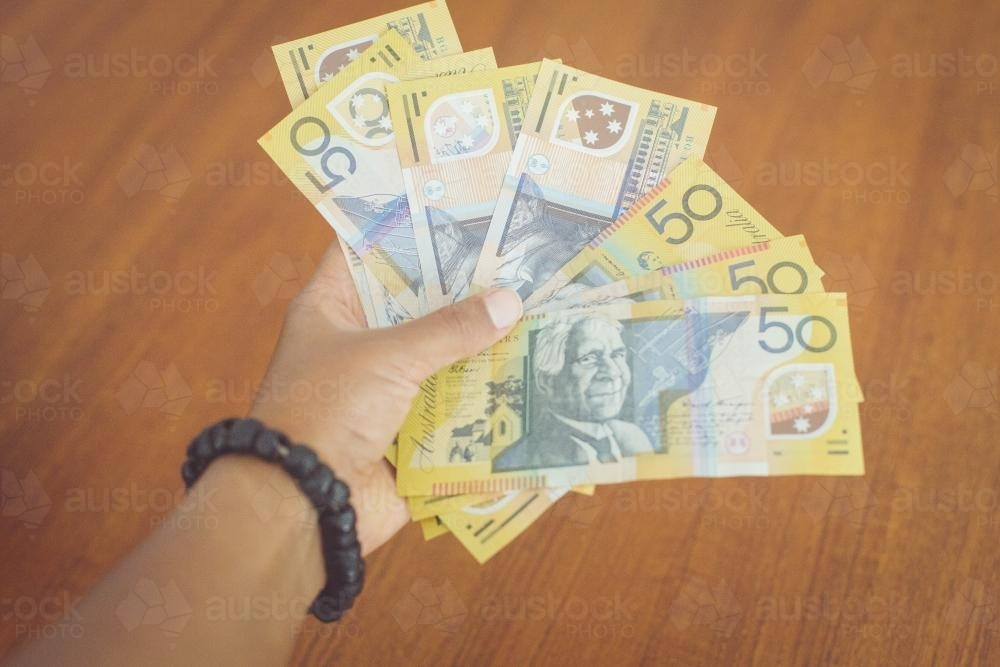 50 Dollar Notes in Hand - Australian Stock Image
