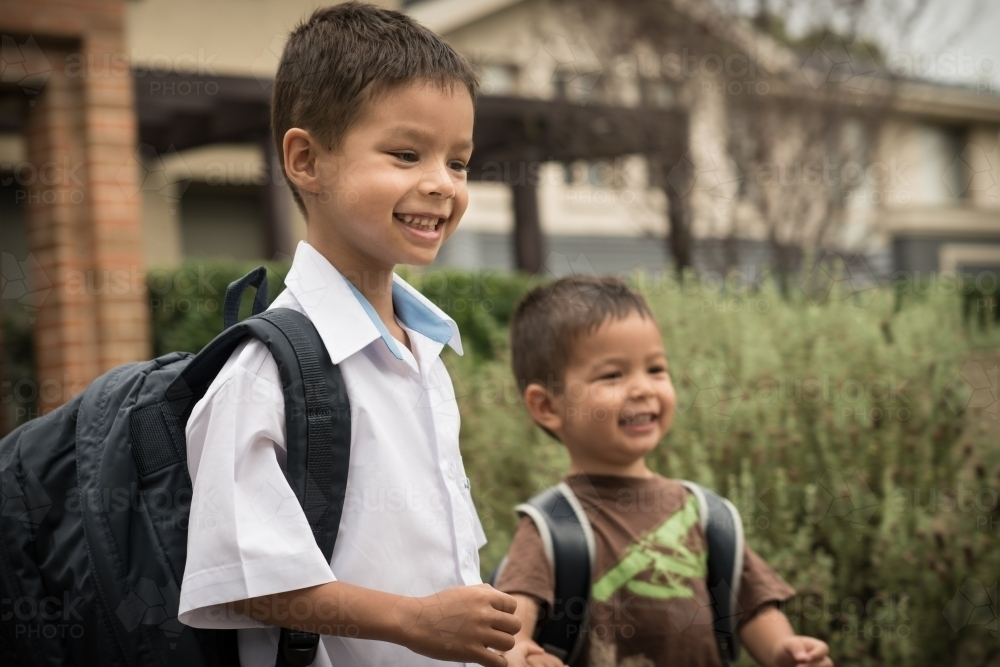 6 year old mixed race boy leaves home for his first day of school - Australian Stock Image