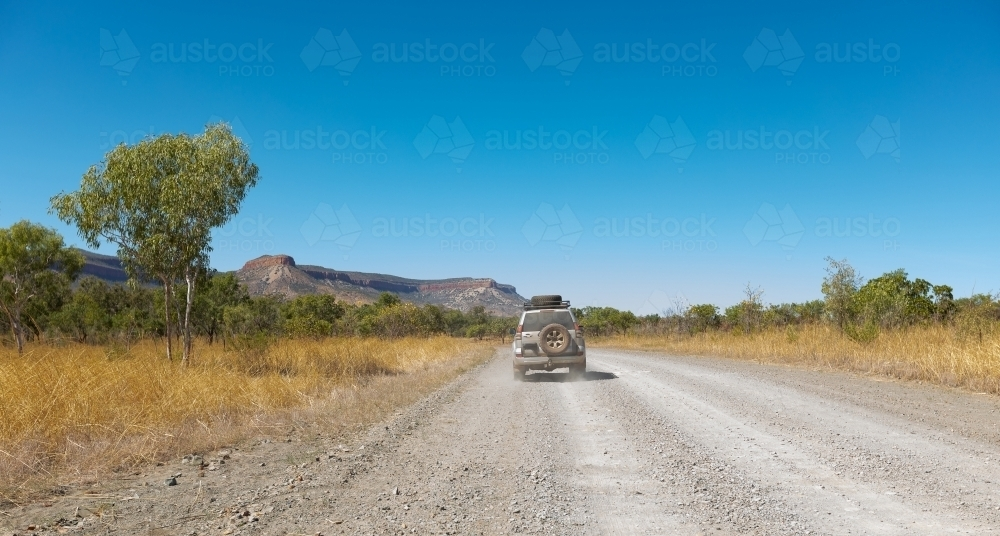 a 4WD vehicle on the gravel Gibb River Road in the Kimberley - Australian Stock Image