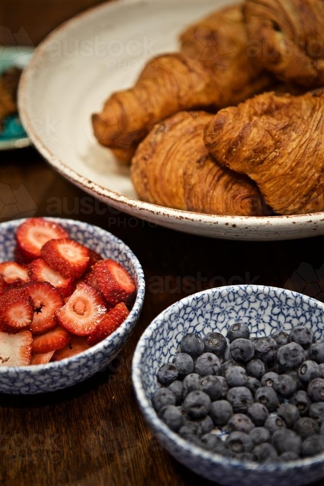A breakfast selection of croissants, strawberries and blueberries - Australian Stock Image