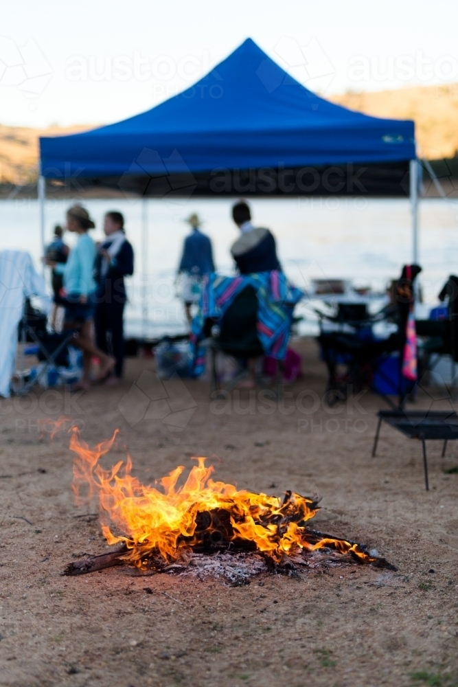 Image of A campfire at a camping weekend with friends ...