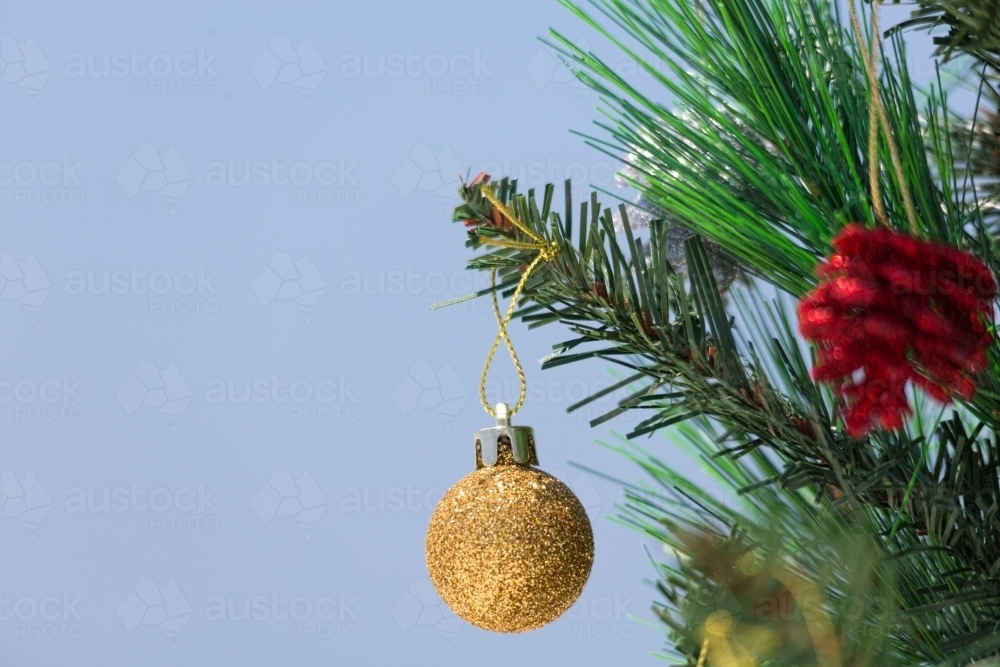 A Christmas tree is decorated with baubles.  A closeup with shallof dof and copy space. - Australian Stock Image