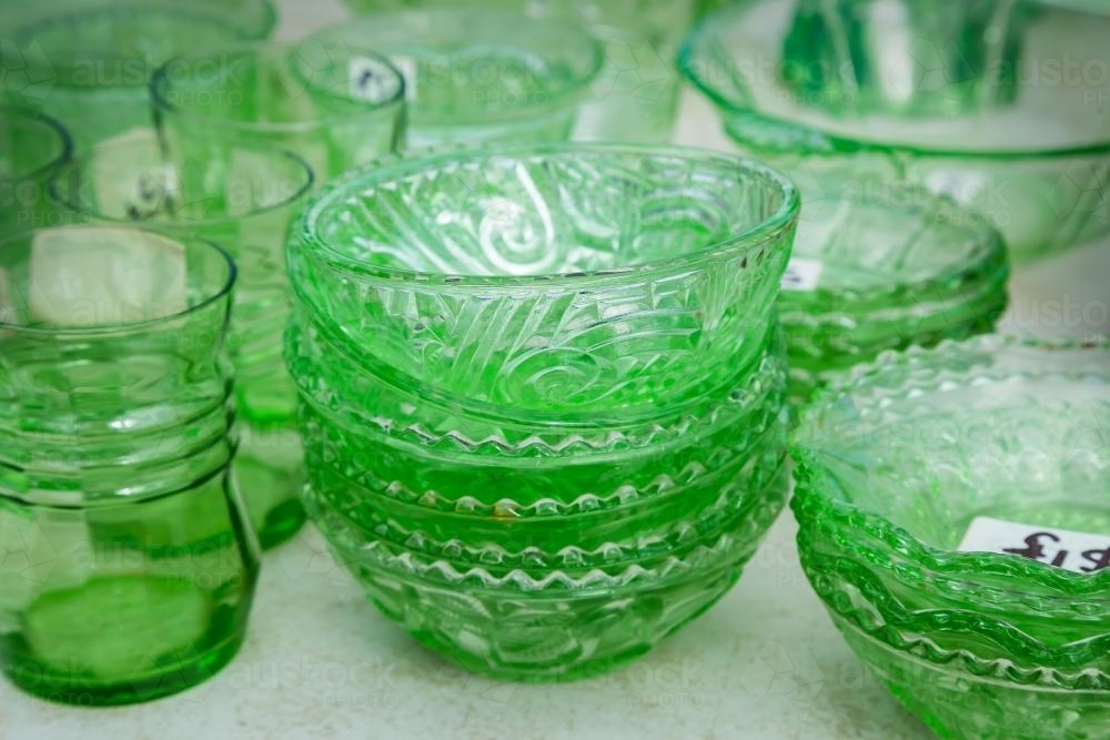 A collection of green glass crockery - Australian Stock Image