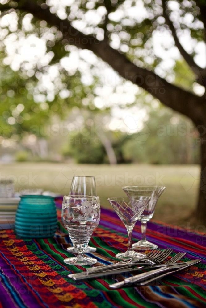 A colourful picnic table set under some trees in bushland - Australian Stock Image