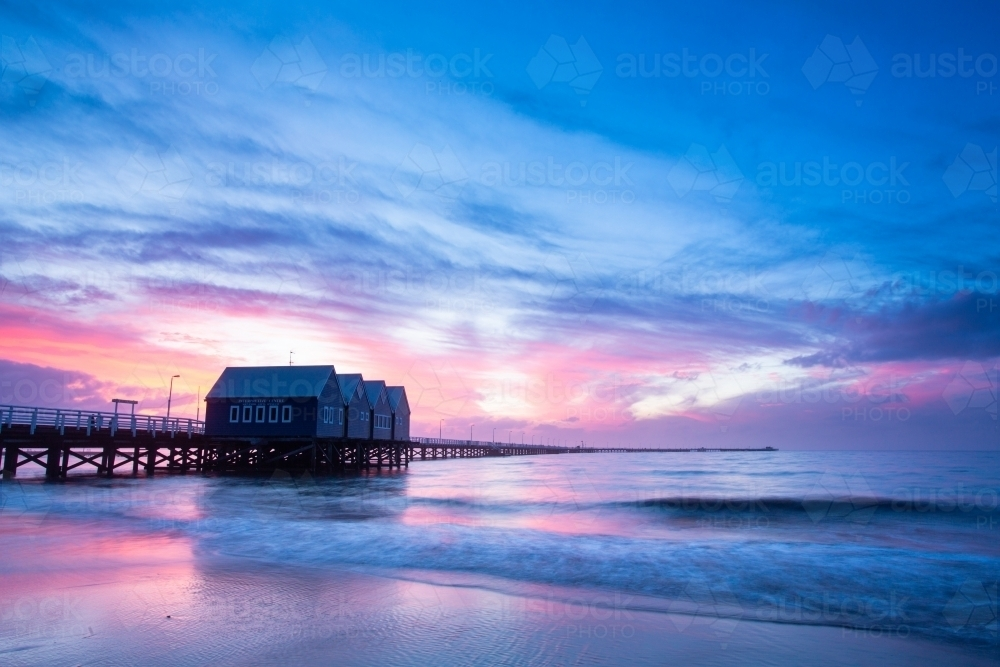 A colourful sunset behind the Busselton Jetty - Australian Stock Image