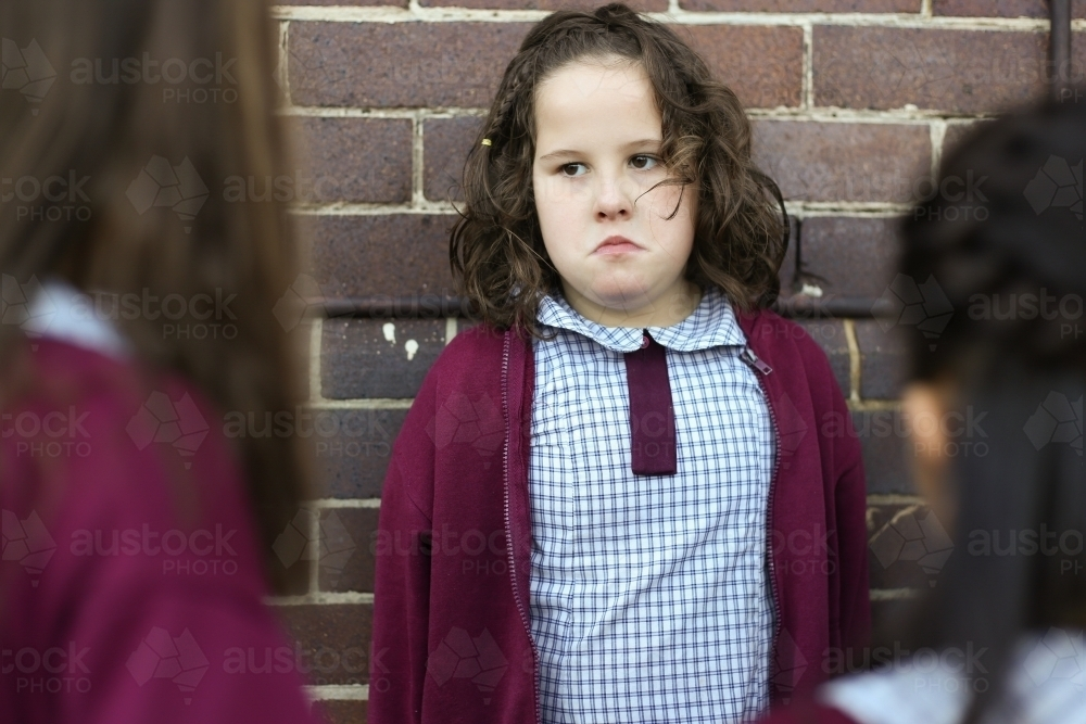 A female school student being bullied by other students in the playground - Australian Stock Image