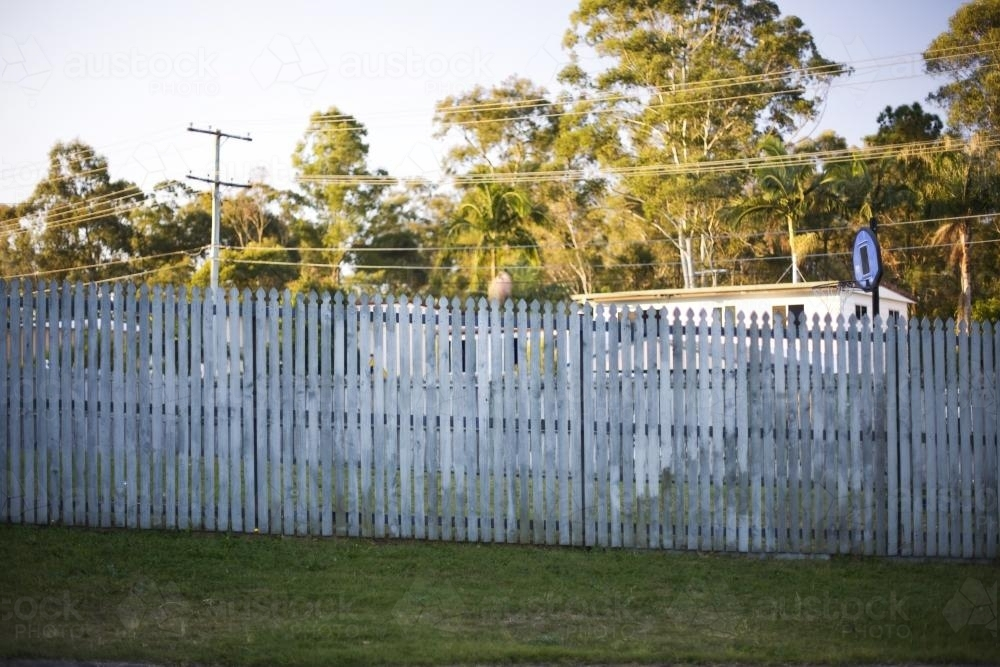 A fence between neighbours in suburbia. - Australian Stock Image