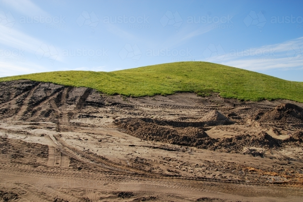 A grassy piece of land that has been excavated during construction works - Australian Stock Image