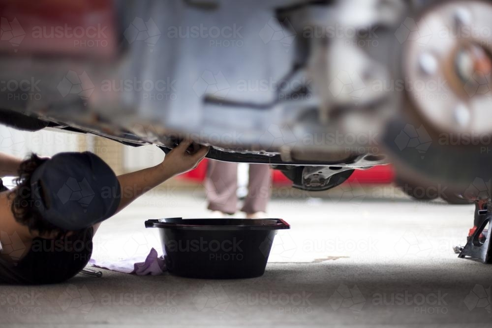 A mechanic services a vehicle. - Australian Stock Image