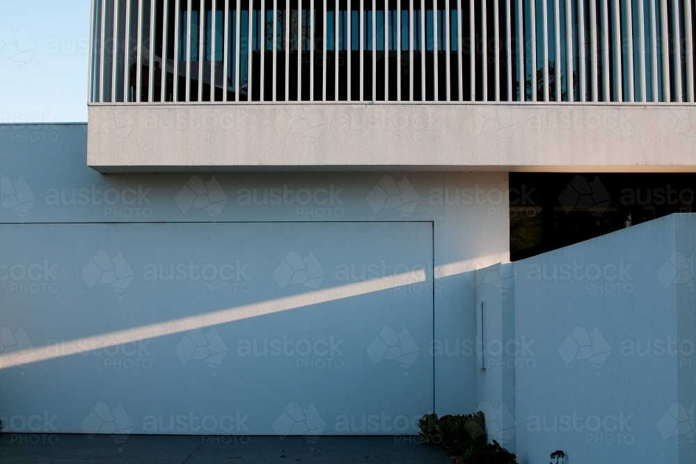 A ray of diagonal light beams across a modern house - Australian Stock Image