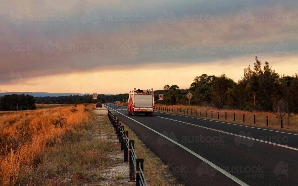 A  Rural Fire Service, fire and rescue vehicle responds urgently to a large out of control bushfire - Australian Stock Image