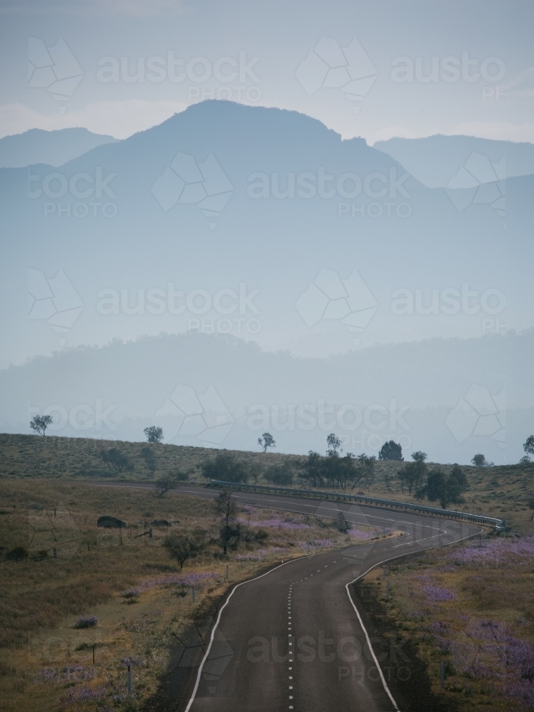 A sealed road leading through the Flinders Ranges - Australian Stock Image