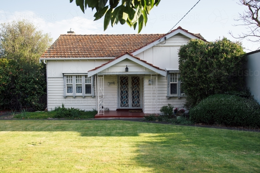 A small, white, old weatherboard house - Australian Stock Image