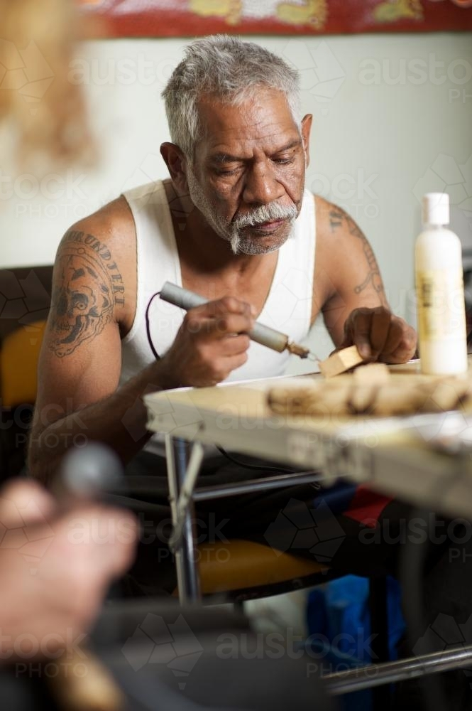 Aboriginal Artist at Work at Table - Australian Stock Image