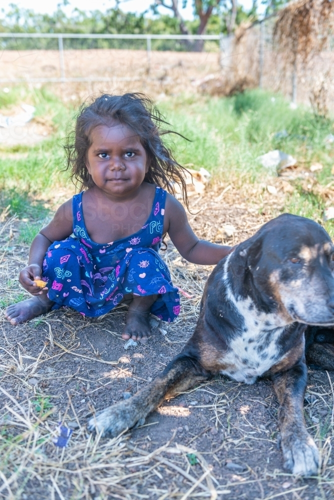 Aboriginal girl with old dog - Australian Stock Image