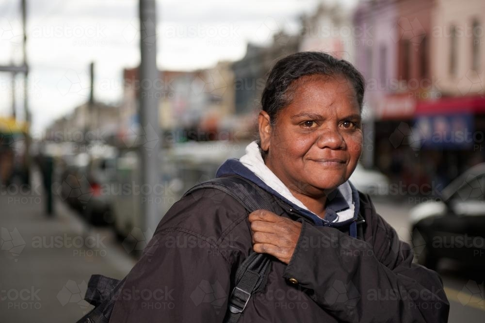 Aboriginal Woman on a Shopping Strip Footpath - Australian Stock Image