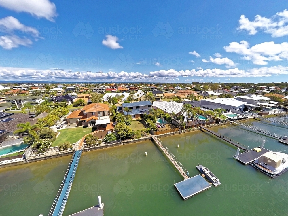 Aerial drone uav footage over waterfront properties with private jetties and solar panels in Newport - Australian Stock Image