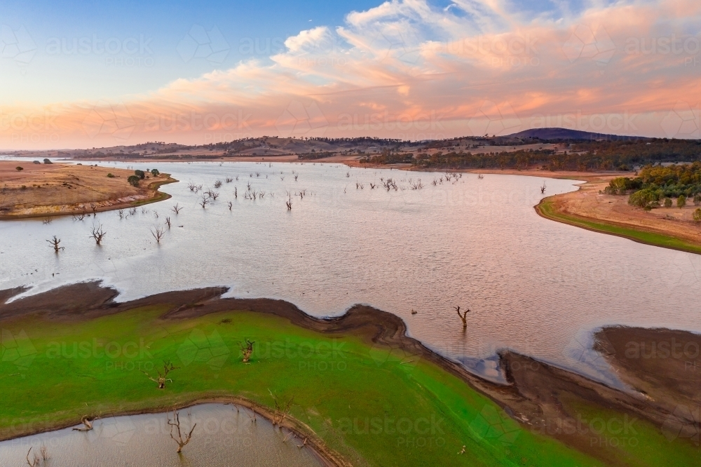 Aerial view of a drying reservoir at sunset. - Australian Stock Image