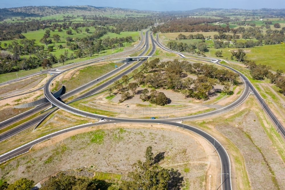 Aerial view of a large roundabout on a freeway - Australian Stock Image