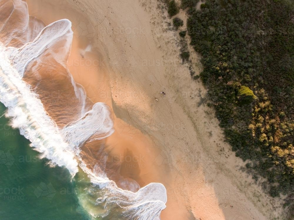 Aerial view of breaking wave washing on a sandy Beach - Australian Stock Image