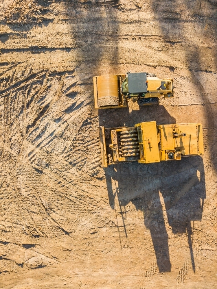 Aerial view of earthmoving machinery on a construction site - Australian Stock Image