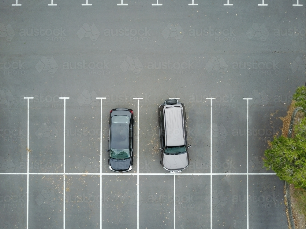 Image Of Aerial View Of Two Cars In Car Park One Of Which Is Over Two Spaces Austockphoto