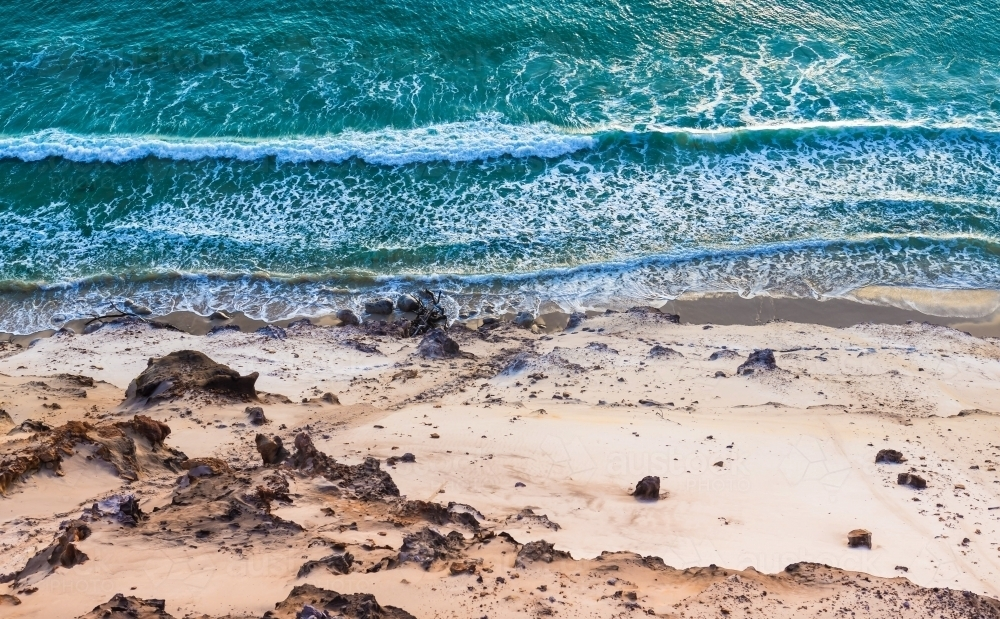 Aerial view of waves crashing on beach - Australian Stock Image