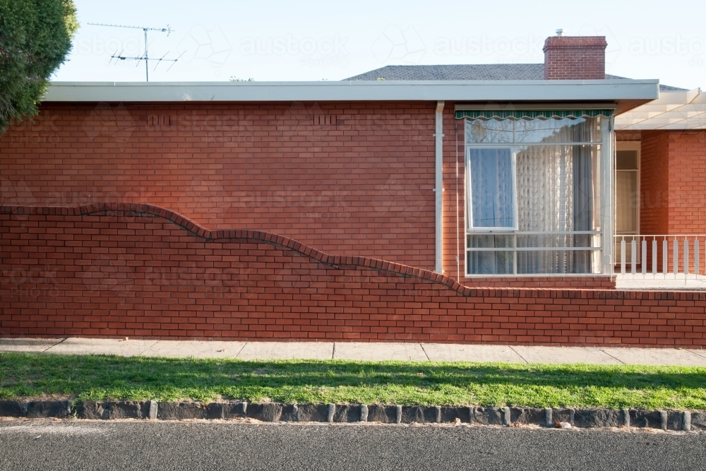 Afternoon sunlight on a retro brick home - Australian Stock Image