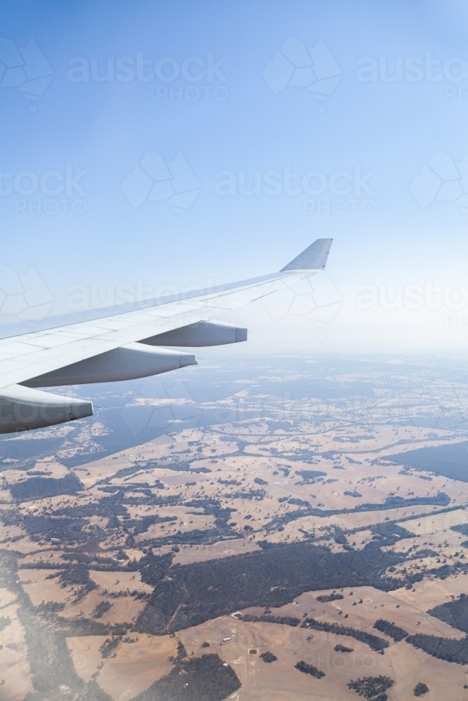Air Plane wing and distant trees and farm land - Australian Stock Image