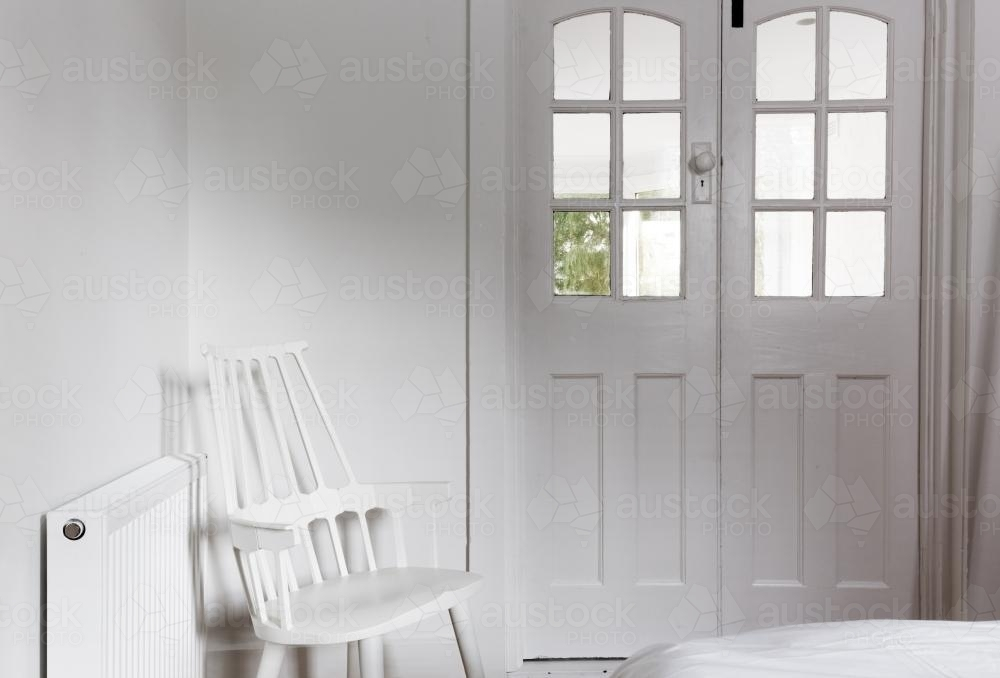 All white interior and decor in a bedroom - Australian Stock Image