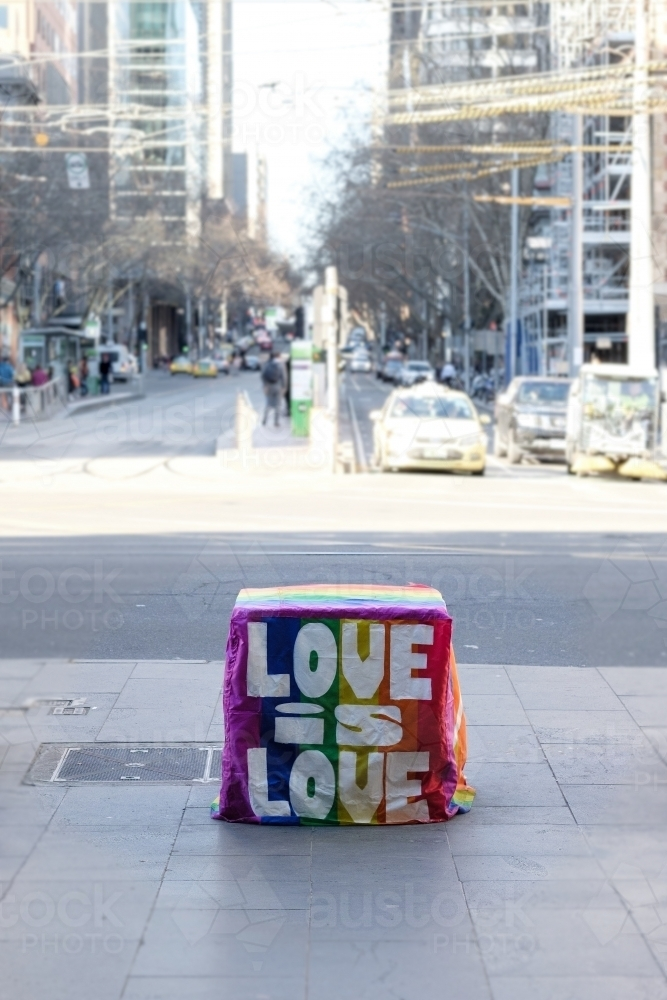 Anti-terrorism bolder adorned with gay rights flag with love is love - Australian Stock Image