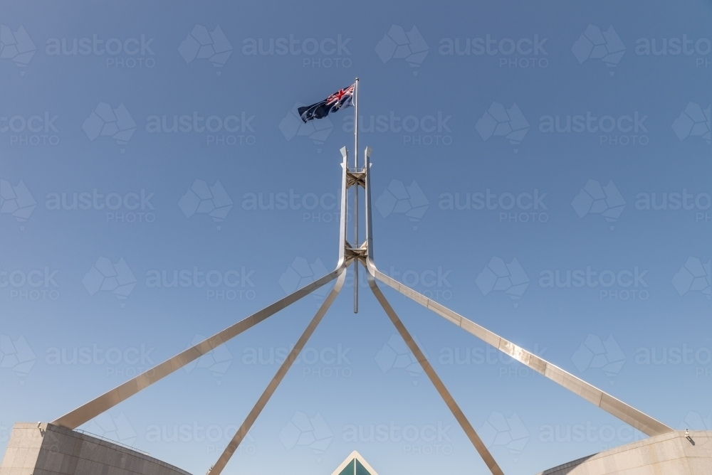 Australian flag above parliament House, Canberra - Australian Stock Image