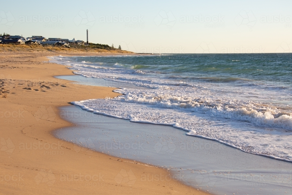 beach at Bunbury looking towards lighthouse - Australian Stock Image