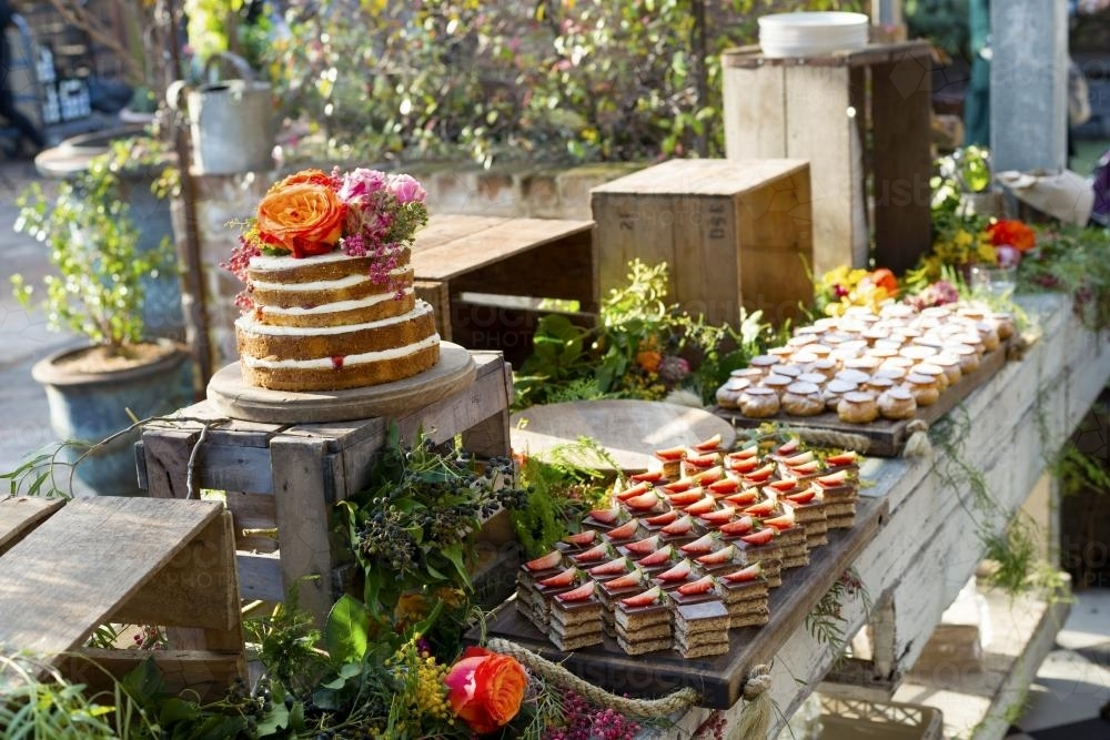Beautiful cakes at birthday with flowers - Australian Stock Image