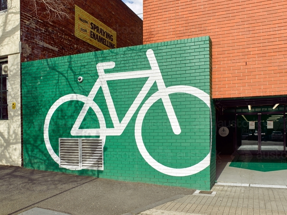 Bicycle graphic on wall in city - Australian Stock Image