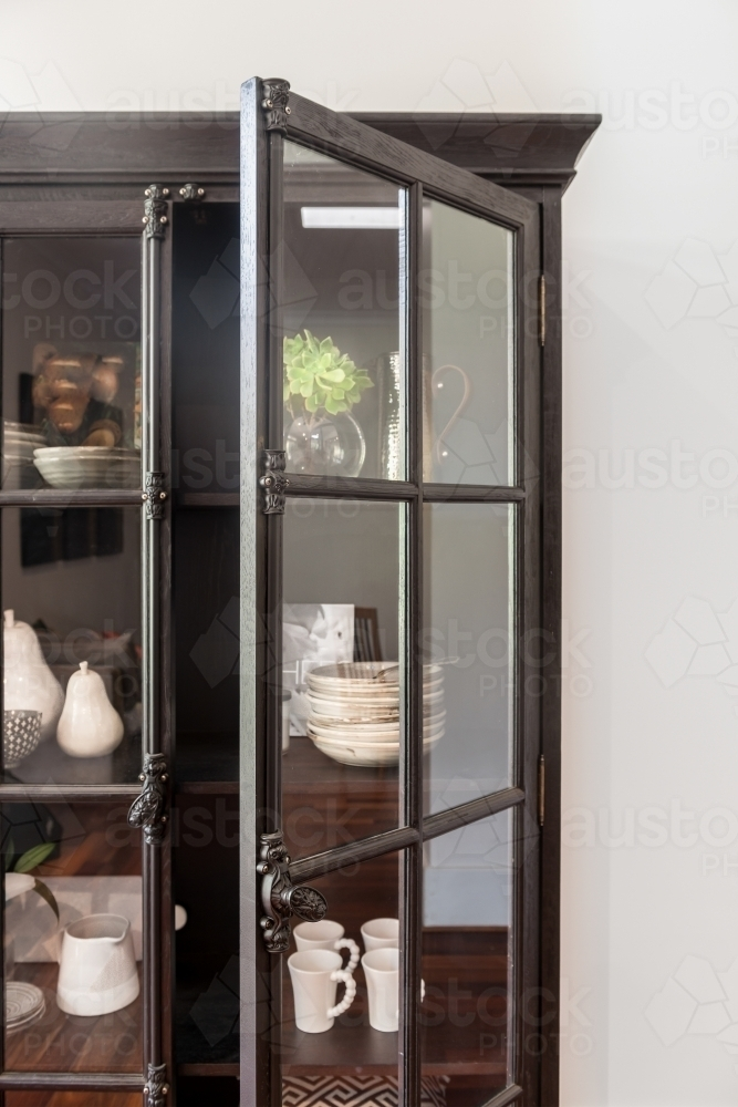 Image Of Black French Inspired Tall Cabinet With Glass Doors Filled