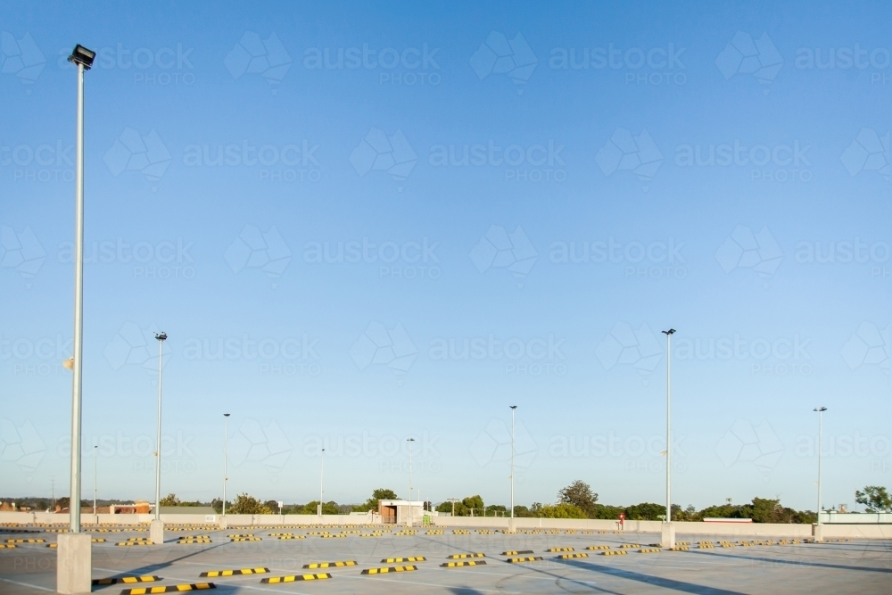 Blue sky with copy space in empty car park - Australian Stock Image