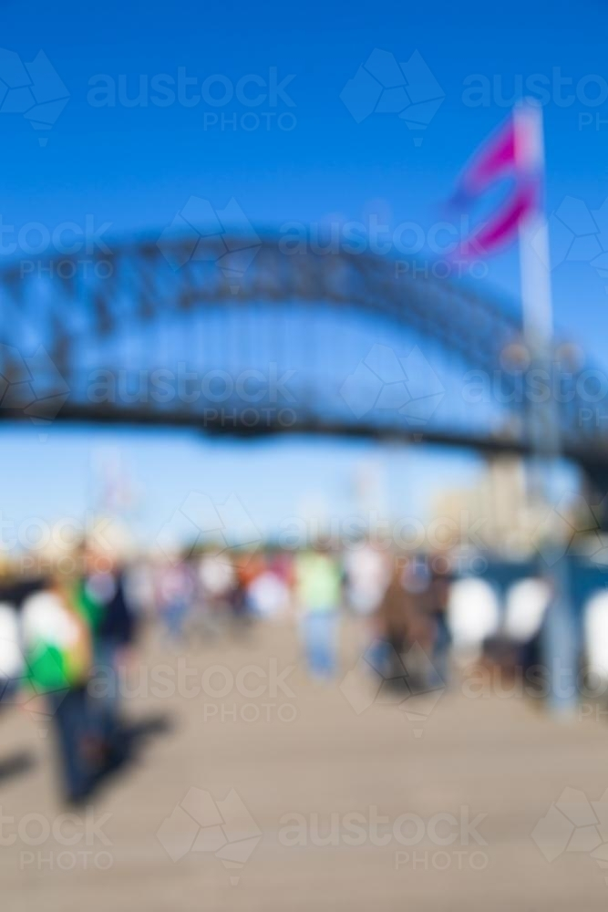 Blurry image of a the sydney harbour bridge and people - Australian Stock Image