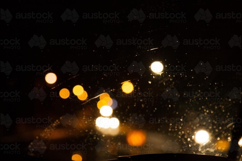 Bokeh of street and car lights at night in the rain - Australian Stock Image
