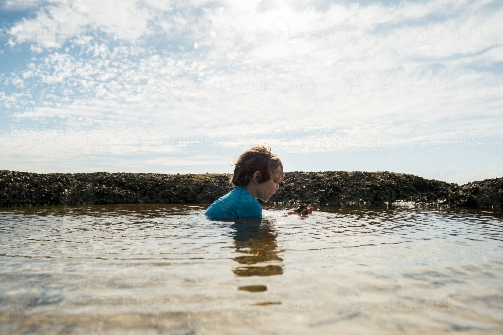 Boy swimming in Rockpool - Australian Stock Image