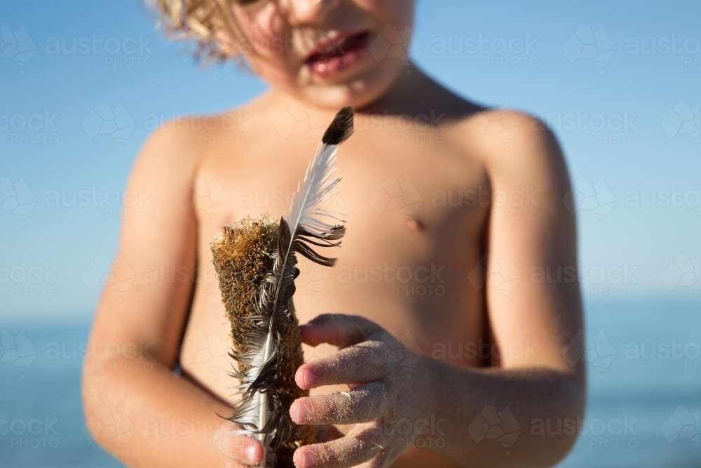 Boy with feather - Australian Stock Image