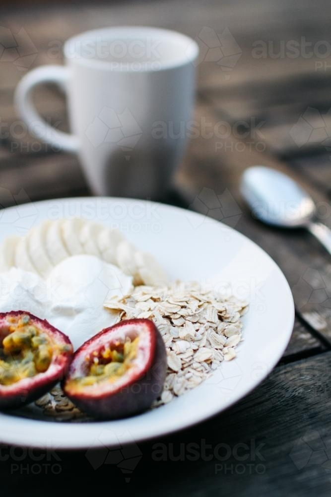 Breakfast Detail with Fruit and Yoghurt on Table - Australian Stock Image