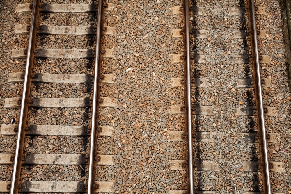 Brown railway tracks and gravel with sleepers and rails - Australian Stock Image