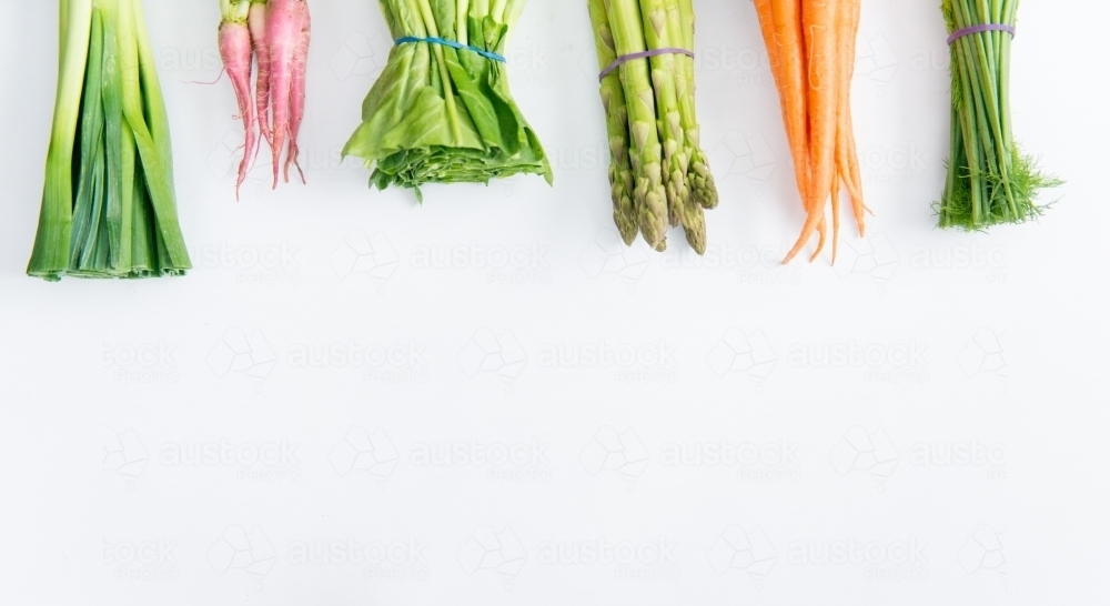 Bunches of Vegetables on white - Australian Stock Image