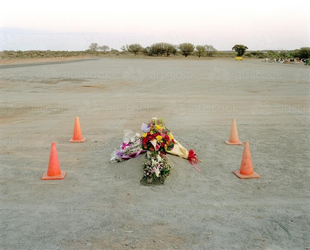Burial site in remote town with flowers - Australian Stock Image