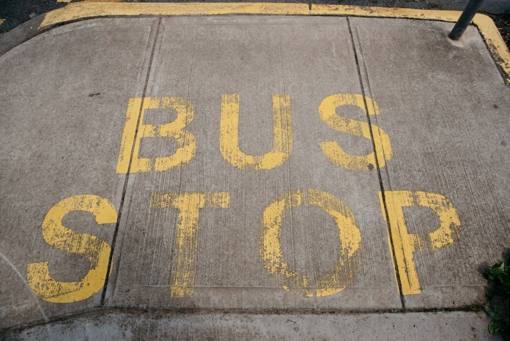 Bus Stop sign painted on pavement - Australian Stock Image